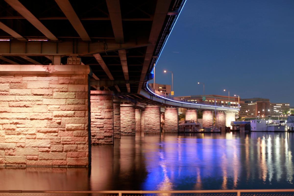 The lighting of the Francis Case Memorial Bridge evolves from sunset to sunrise