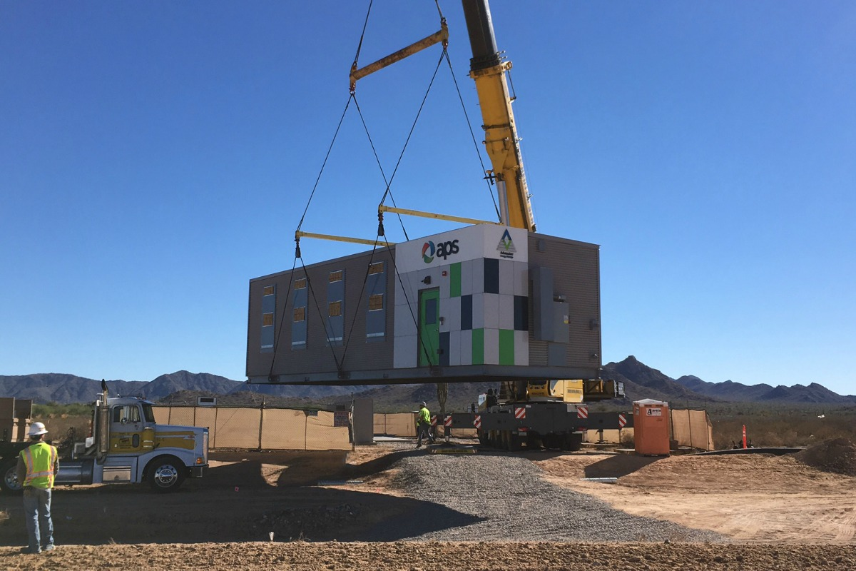 The energy storage arrays are lowered onto the Arizona desert