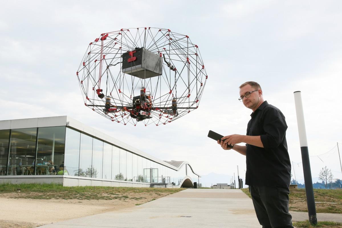 Przemyslaw Kornatowski from EPFL with his foldable, self-flying drone