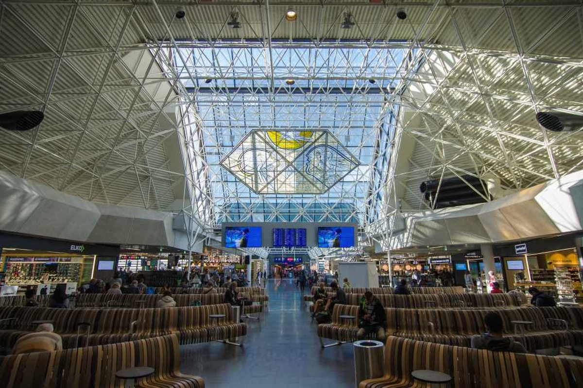 Wait times and flight information are communicated on screens and via a mobile app