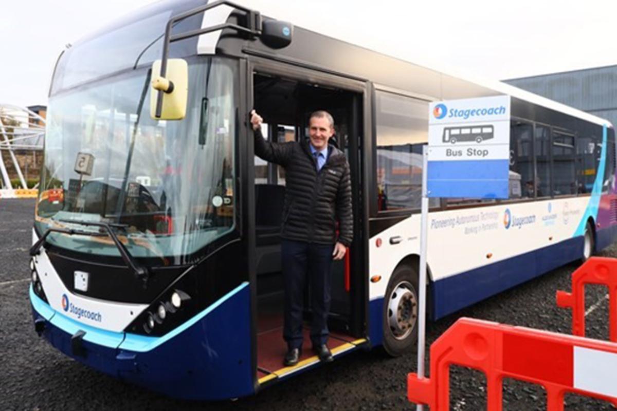 Cabinet secretary Michael Matheson with the autonomous bus