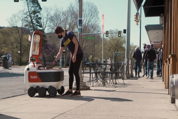 Student diners receive a push notification as the robot approaches